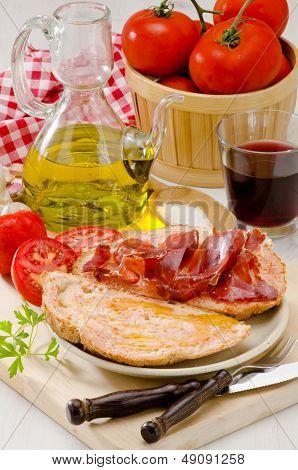 Spanish Cuisine. Tomato Bread And Serrano Ham. Pa Amb Tomaquet I Pernil.