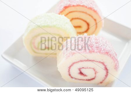 Colorful Jam Roll Cakes  On White Background