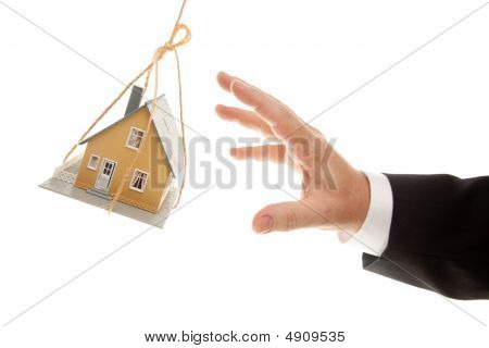 Swinging House And Business Man's Hand Reaching Or Pushing