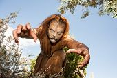 A human Lion creature reaches out menacingly to grab you. Looking into the camera. Character created by renowned special fx make-up artist Rayce Bird. poster