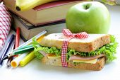 sandwich with ham, apple, banana and granola bar - healthy eating, school lunch poster
