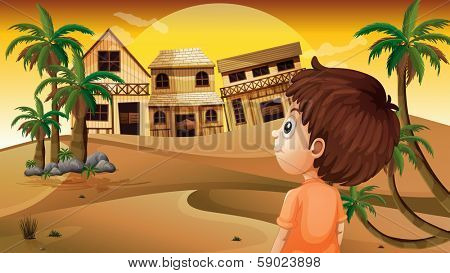Illustration of a boy at the desert standing in front of the wooden houses