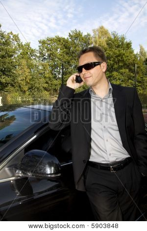 Business Man In Front Of A Car