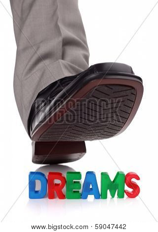 Businessman foot about to tread on someone's dreams - concept for broken dreams, bullying or oppression