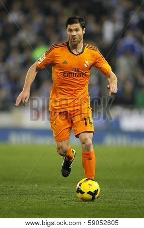 BARCELONA - JAN, 12: Xabi Alonso of Real Madrid during the Spanish League match between Espanyol and Real Madrid at the Estadi Cornella on January 12, 2014 in Barcelona, Spain