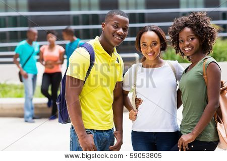 group of smiling african american college friends outdoors