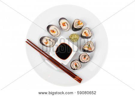 Maki Sushi : Maki Rolls and California rolls made of fresh raw Salmon(sake), Tuna(maguro) and Eel(unagi) . on white dish with sticks isolated over white background