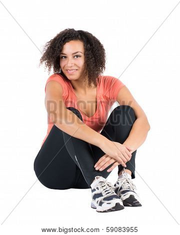 Young Sportswoman Sits On The Ground
