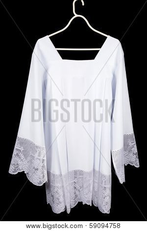 White lace surplice or chorrock as worn over a cassock by priests, acolytes or choir singers
