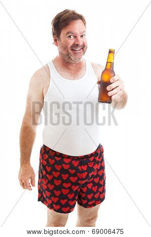 Scruffy middle aged man in his underwear offering you a bottle of beer.  Isolated on white.