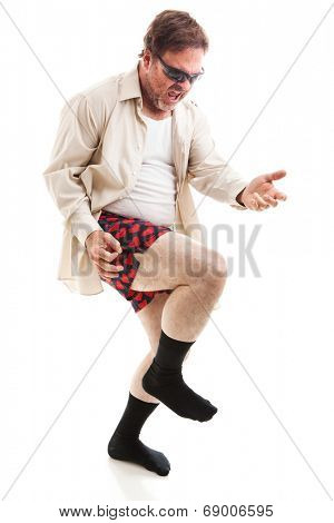 Fifty year old man in his underwear and sunglasses playing air guitar.  Isolated on white.
