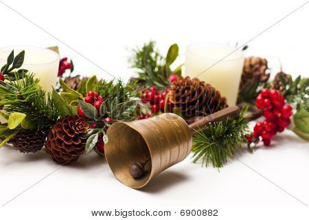 Bell And Christmas Arrangement On A White Table