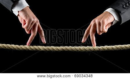 Two Male Hands Making The Walking Sign On A Rope