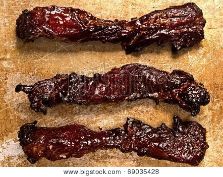 close up of rustic chinese char siu roast pork poster