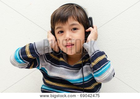 Little Boy Listening The Music With Headset