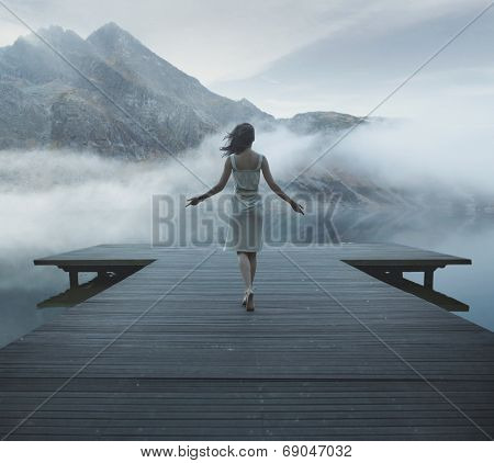 Woman on a wooden bridge