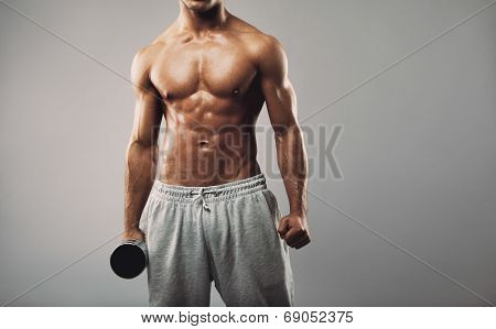 Shirtless Young Muscular Man With Dumbbell