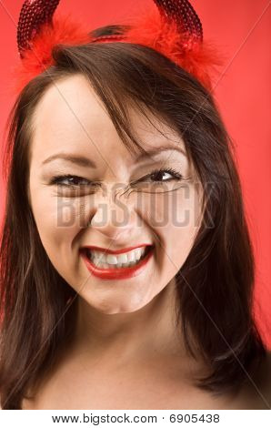 Young Woman In Devils Horns