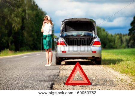 Woman With Telephone Near The Broken Car