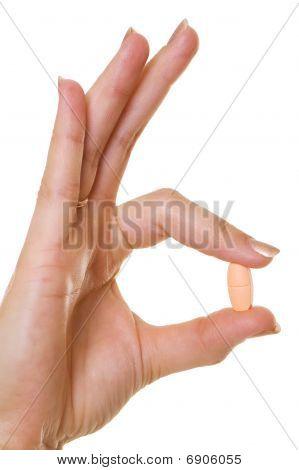 Woman Hand Holding Pill