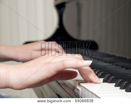 Detail Of Teenager Hands Playing The Piano