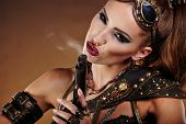 Steampunk woman over gunge background. . Fantasy fashion for cover.  poster