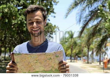 travel lifestyle: male tourist with map