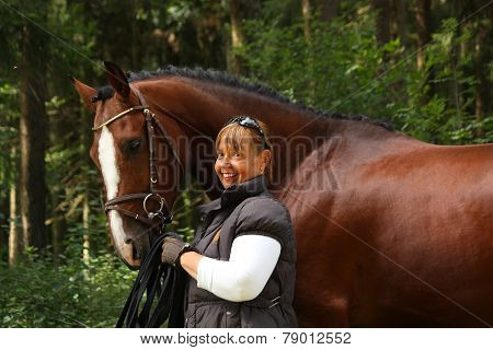 Elderly Woman And Brown Horse Portrait In The Forest