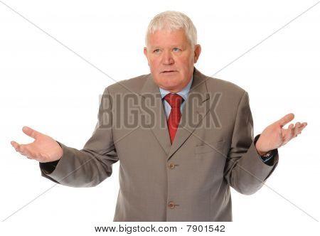 Successful Mature Businessman Shrugging
