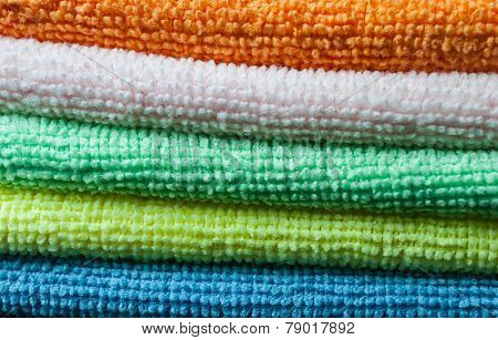 Closeup stack of colorful towels. Horizontal layout.
