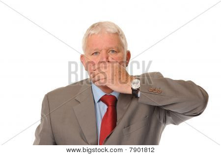 Successful Mature Businessman Covering Mouth