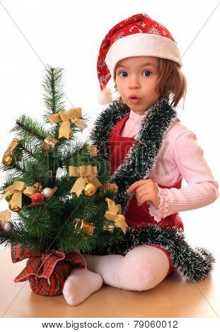 Girl with new-year tree.