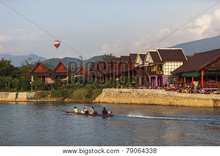 Unidentified tourists are on long-tailed boat tour in Song River