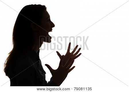 profile of screaming woman in silhouette
