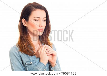 woman touching her wedding ring thinking about marriage problems isolated