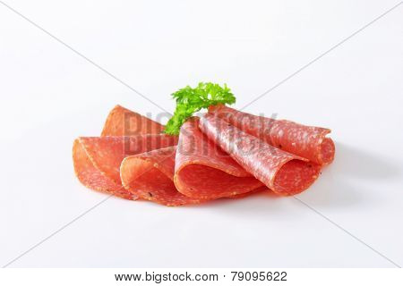 Thinly sliced salami infused with pieces of black truffles