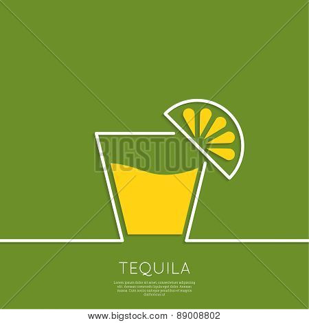 Glass of tequila with lemon.