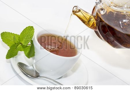tea poured from a teapot