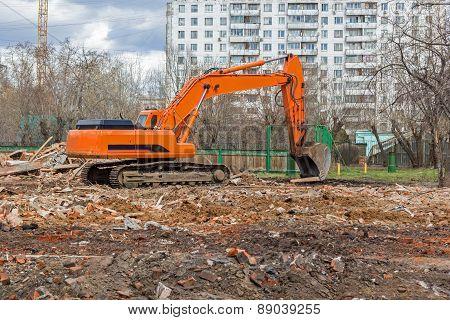 Excavator Removes Construction Waste After Building Demolition