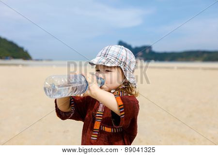 Child On Tropical Beach, Drinking Bottled Water