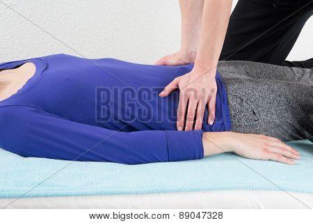 Nice And Young Woman Having A Shiatsu Massage