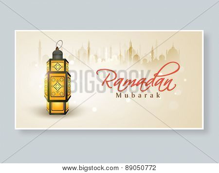 Traditional illuminated arabic lamp or lantern on mosque silhouette background for holy month of muslim community, Ramadan Kareem celebration.
