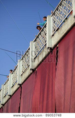 Men fishing on the Galata Bridge, Istanbul, Turkey