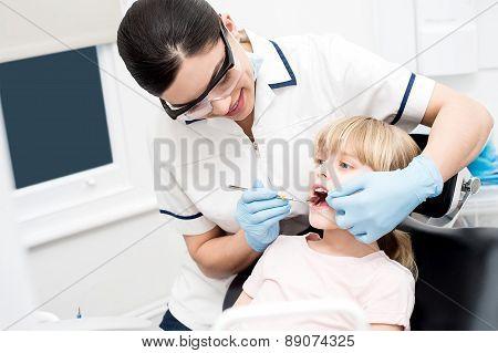 Little Girl At Dental Clinic.