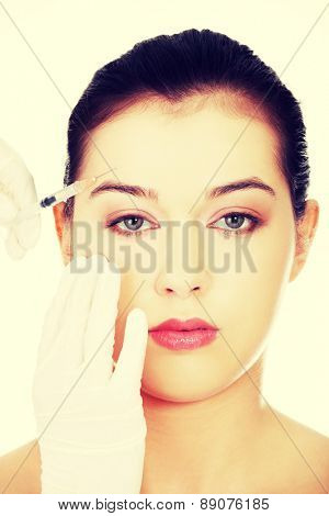 Cosmetic botox injection in the female face poster