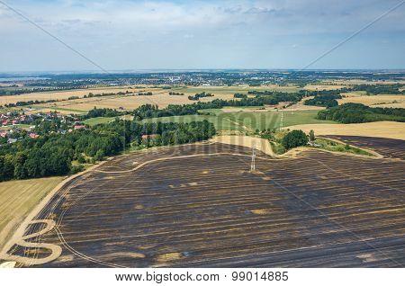 Powerlines On Wheat Field