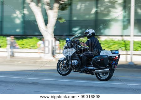 Police Officers On Motorcycles Performing