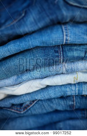 Jeans In Assorted Shades Of Blue, Folded And On Display