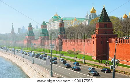 Kremlin's fortified complex palace and golden onion-domed cathedrals with the Moskva River and road. Russia Moscow poster