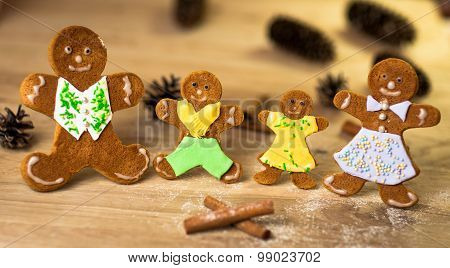 gingerbread men on the wooden floor with Christmas decorations